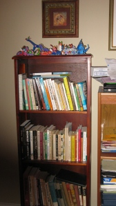 My Oaxacan Critters atop more books
